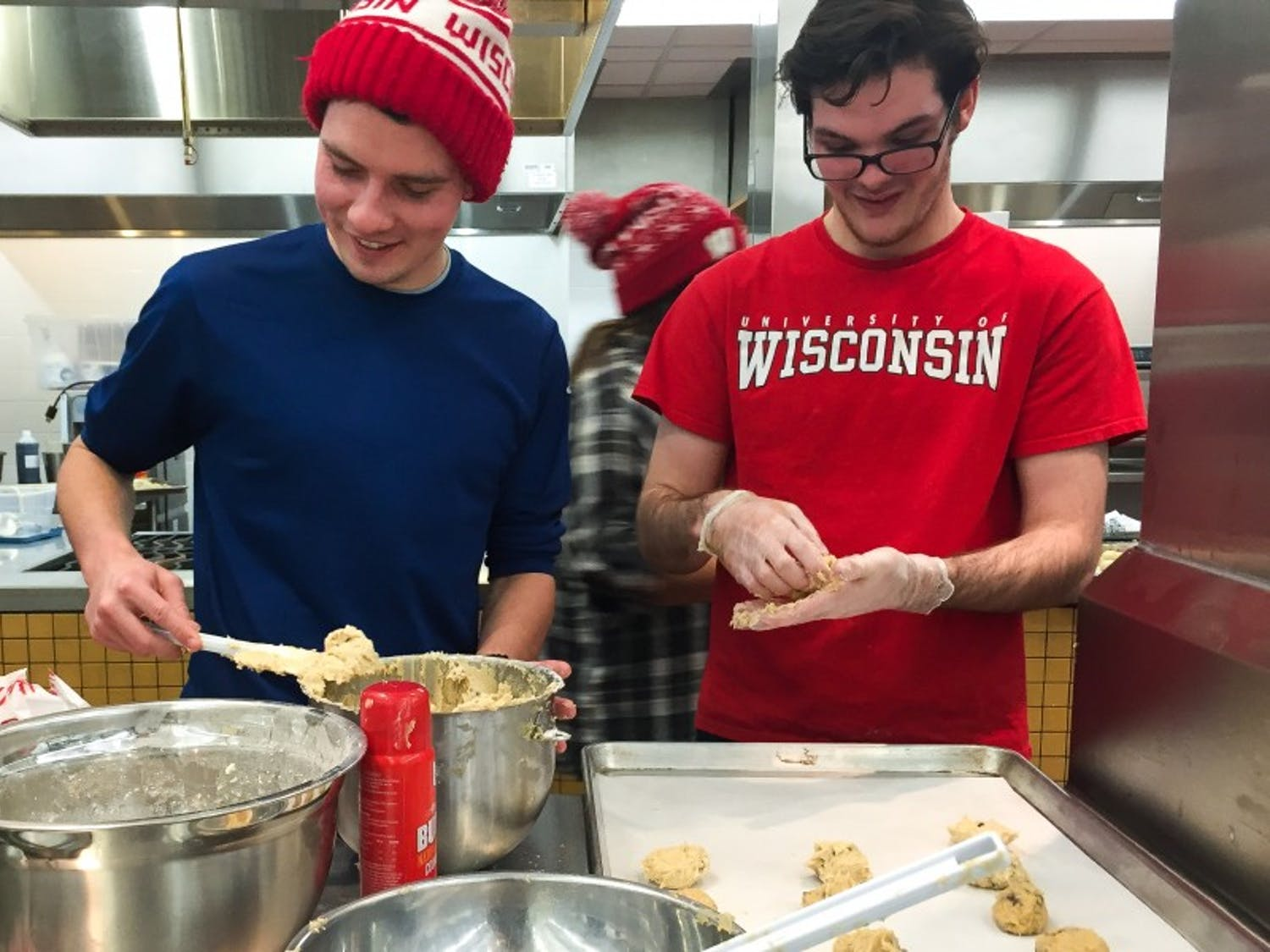 UW-Madison students participated in the event Sweets for Smiles, which was organized by Wisconsin Union Directorate Cuisine and WUD Alternative Breaks, to discuss homelessness and bake food for individuals in shelters.
