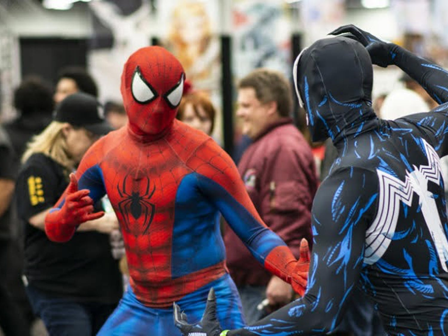 Two convention goers dressed as Marvel's Spider-Man and Venom do battle at Wizard World Comic Con.