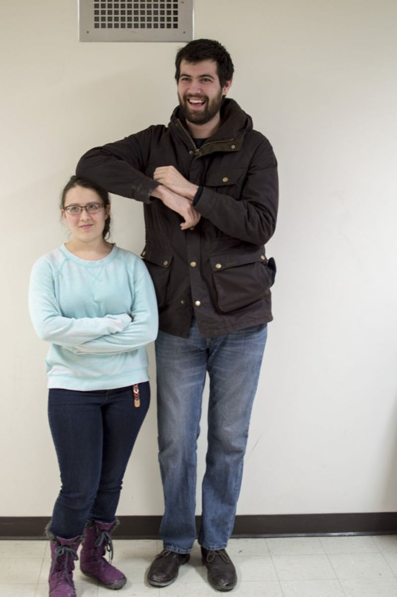 Armrest Sarah Cander relishes with exuberance as she provides blissful comfort to much taller friend James Ford.