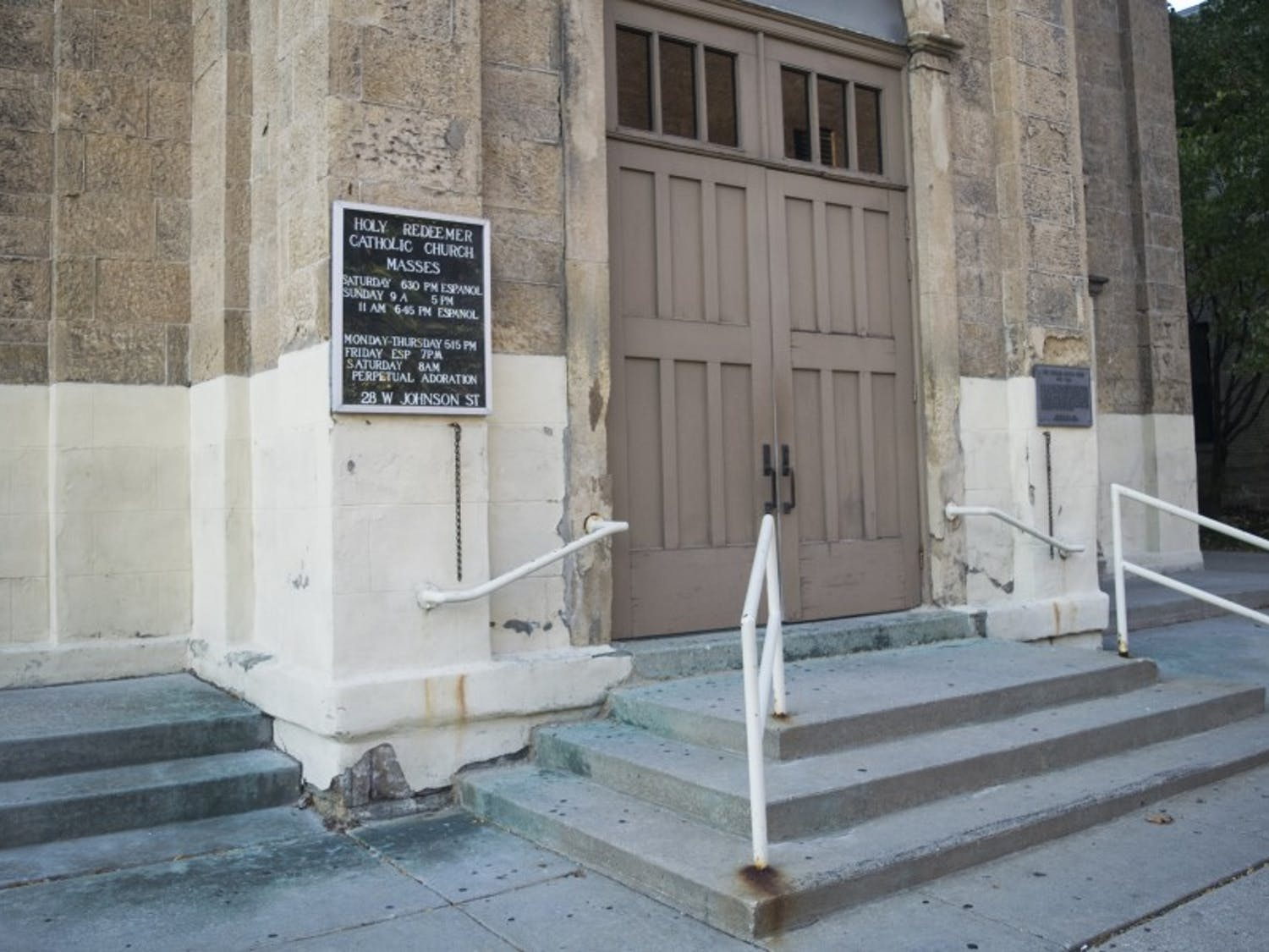 Suburban churches in the Madison area have taken precautions regarding additional security measures, while downtown churches have been more reluctant.