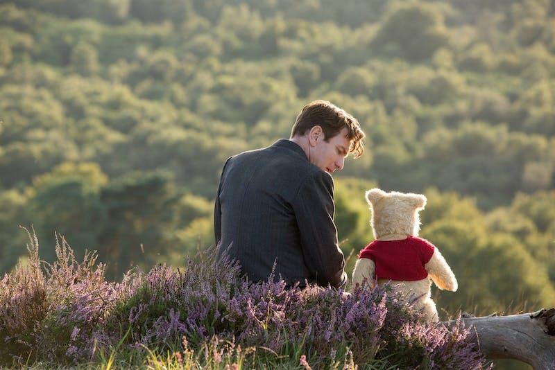 """In """"Christopher Robin,"""" Ewan McGregor stars as Pooh Bear's best friend who revists his happy childhood amid his struggles with adulthood and a life with less fantasy."""