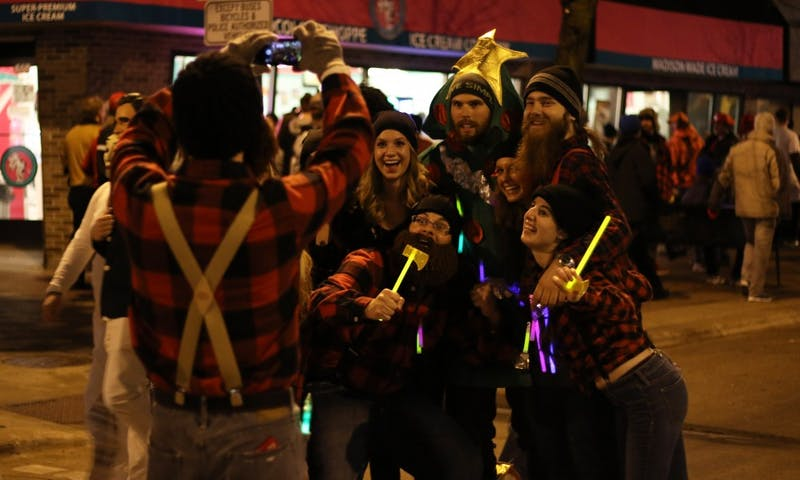 Local residents enjoy the festivities of Freakfest on State Street by posing for a celebratory photo.
