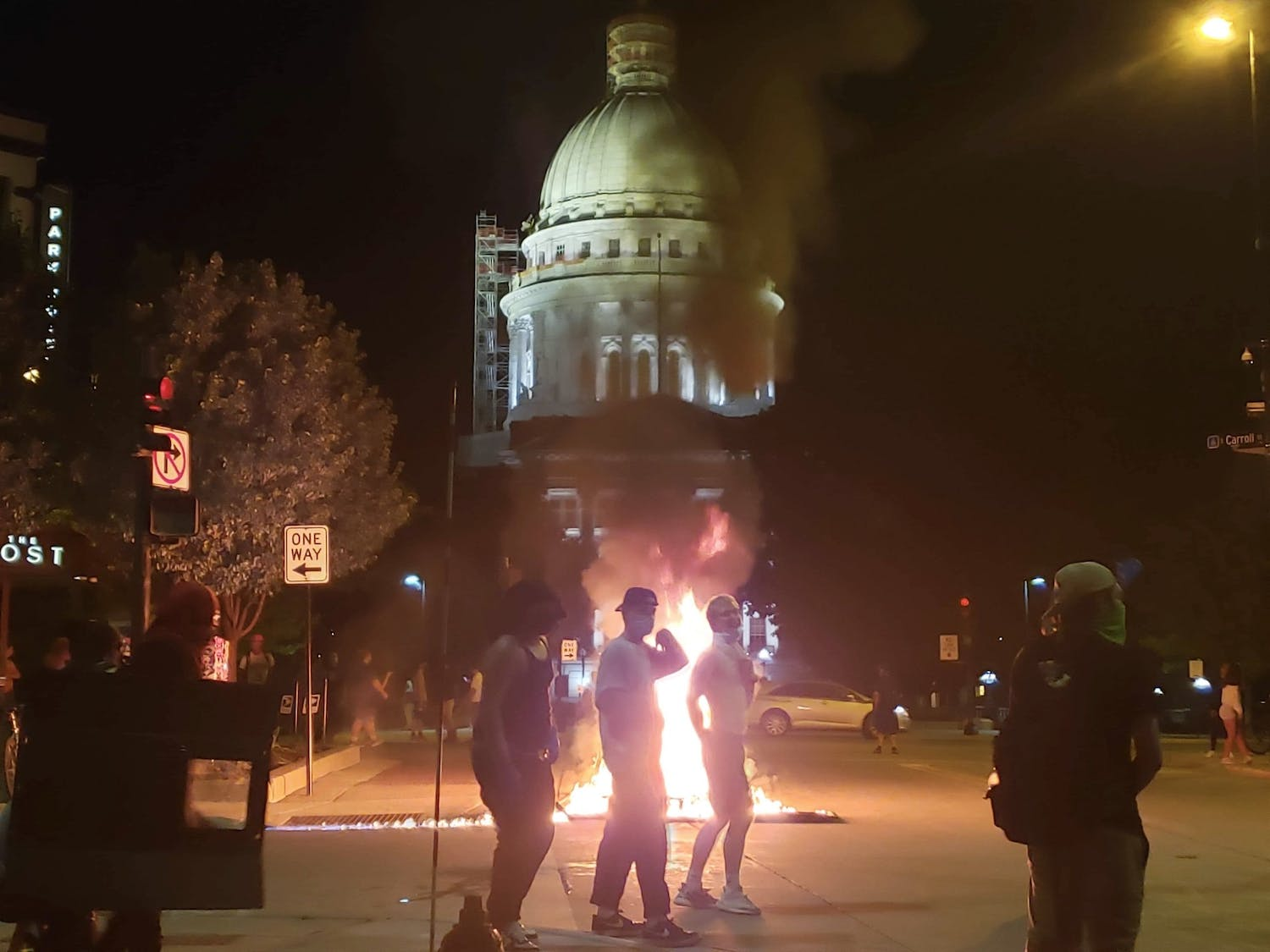 Protesters stand beside a fire in front of the Capitol building Monday night.