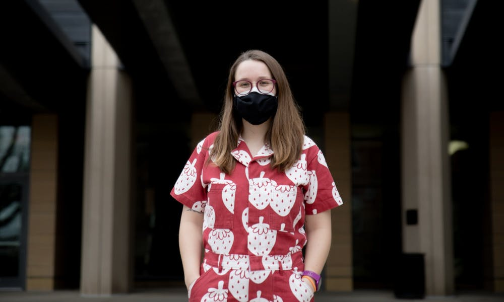 Photo of Charlotte Francoeur outside of the Microbial Science Building.
