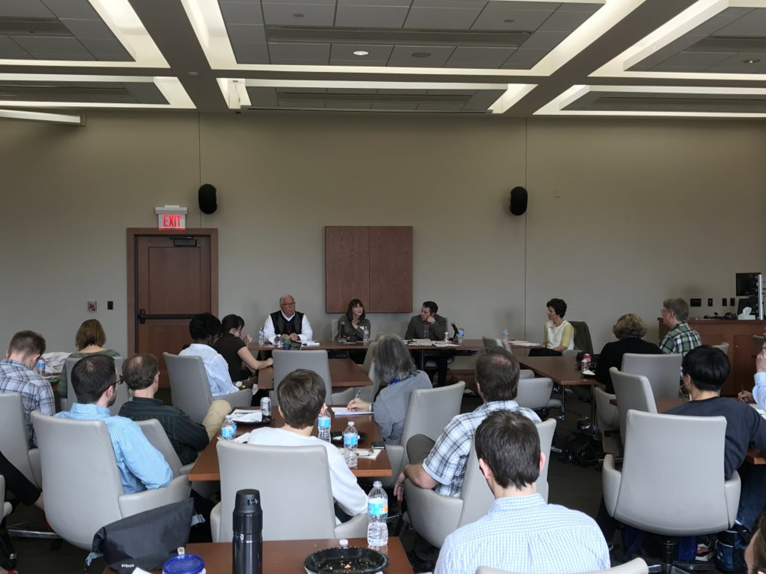 Lawmakers and researchers discussed barriers to increased collaboration between the university and state government Monday at a panel discussion.