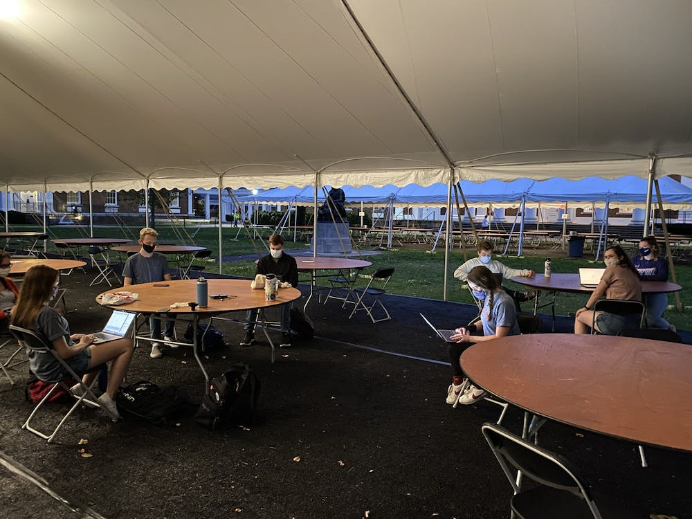 <p>The University Democrats have gathered in open University spaces like the Lawn in masked and distanced groups of less than 10 to phone bank.</p>