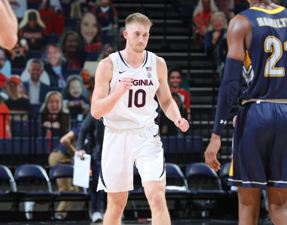<p>Senior forward Sam Hauser's scoring was crucial for Virginia in the overtime period as he led the Cavaliers to a tight victory.</p>
