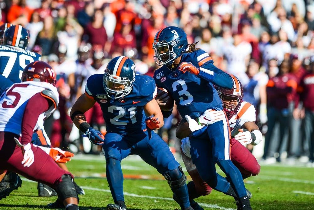<p>Quarterback Bryce Perkins played an immense role in Virginia's first win over rival Virginia Tech in 15 years.&nbsp;</p>
