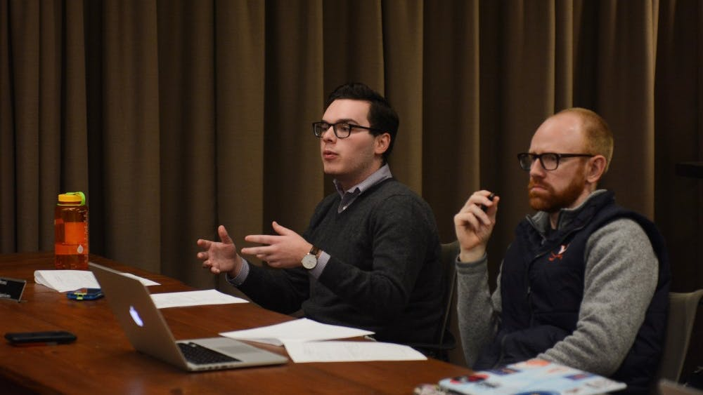 Peyton Sandroni (left), a fourth-year Engineering student and vice chair for investigations, speaks at Sunday's meeting.