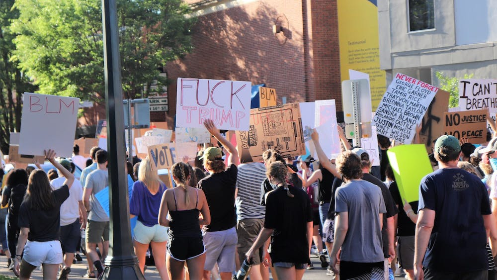 As the crowd grew in size on its trek to the University, protesters flooded West Main Street and University Avenue, forming a wall of people that could be clearly seen for nearly half a mile.