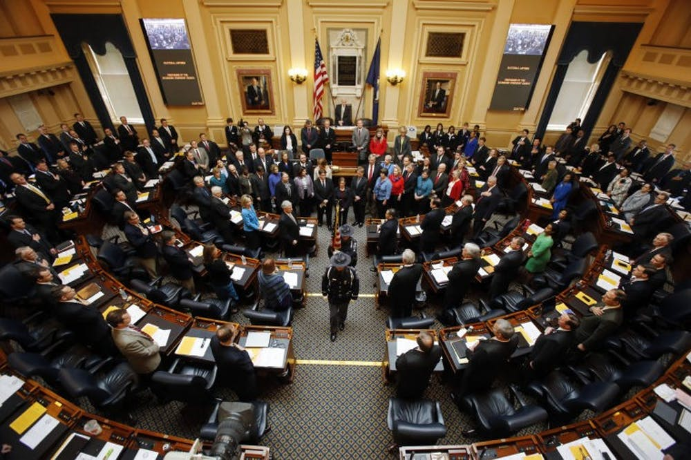Members of the Virginia Capitol Police retire the colors after the Richmond Symphony Chorus (encircling the Speaker's podium) sang the National Anthem to open the 2013 session of the Virginia House of Delegates at the State Capitol in Richmond, VA Wednesday, Jan. 9, 2013.