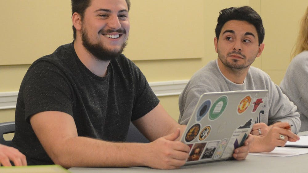 Taylor Overton (left), a second-year College student and former chief of cabinet, was appointed as the vice president for administration by Student Council president Alex Cintron (right) Tuesday night.