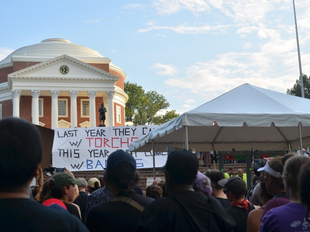 Protesters gather outside the Rotunda to protest the police presence on Aug. 11, 2018.