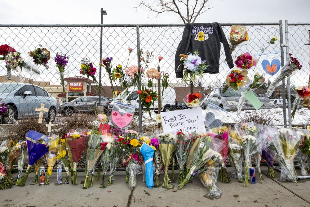 <p>Hundreds of people visited the site of a mass shooting at a Boulder, Colo. King Soopers to leave flowers, cards and candles on March 23, 2021.</p>