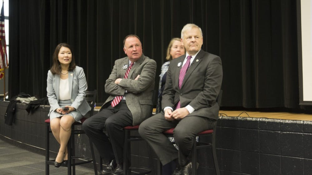 Dr. Jennifer Lee, Del. David Toscano and Sen. Creigh Deeds at the town hall Tuesday evening.