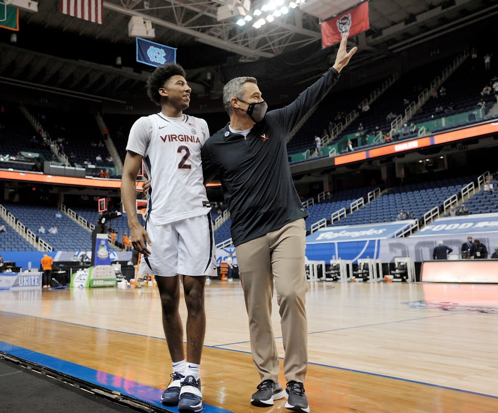 <p>Virginia Coach Tony Bennett and freshman guard Reece Beekman celebrate after beating Syracuse Thursday in the ACC Tournament quarterfinals</p>