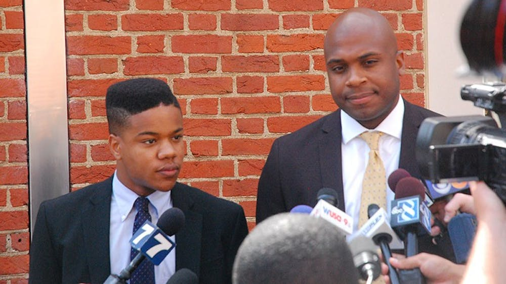 Martese Johnson and his lawyer, Daniel Watkins, speak to press.