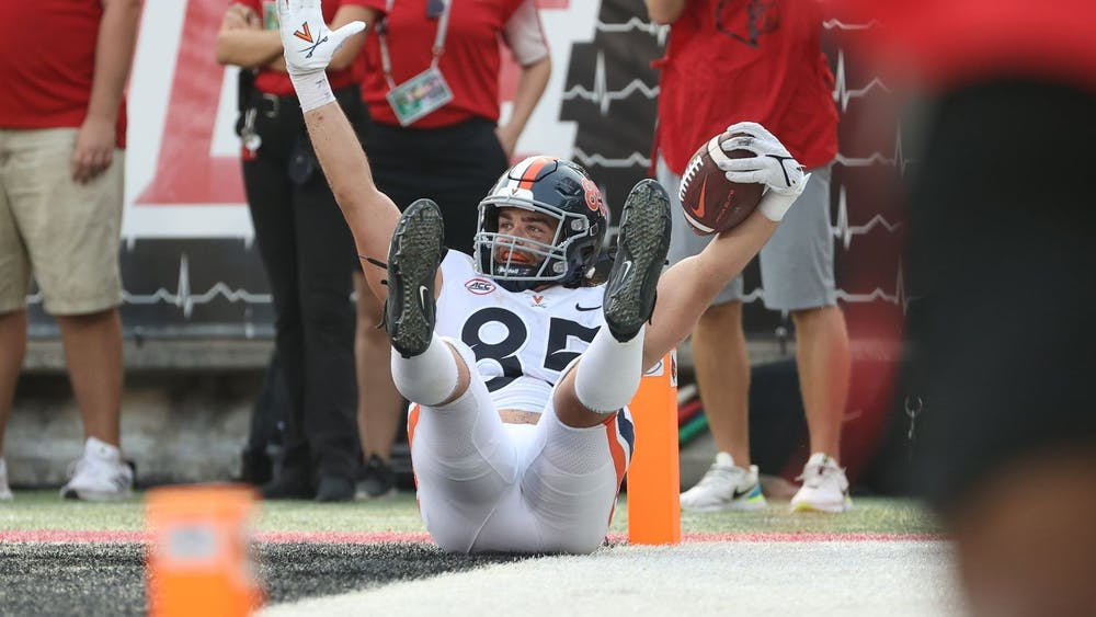 Virginia junior tight end Grant Misch celebrates after scoring the game-winning touchdown with less than 30 seconds remaining against Louisville Saturday afternoon.