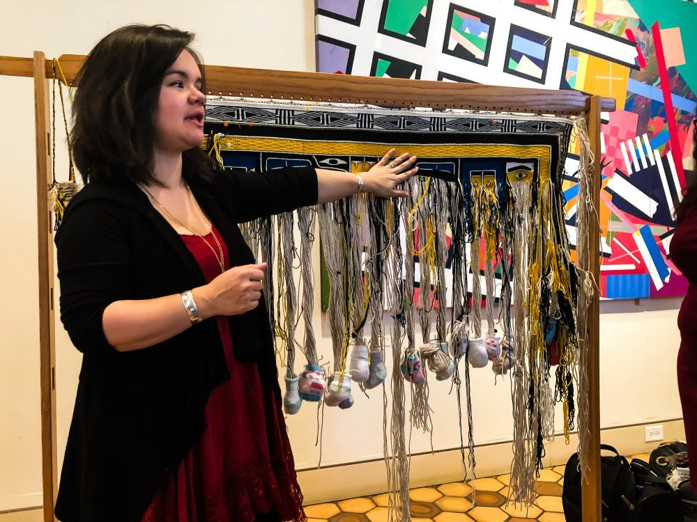 Artist Lily Hope demonstrates the craft of Chilkat weaving at the Fralin.