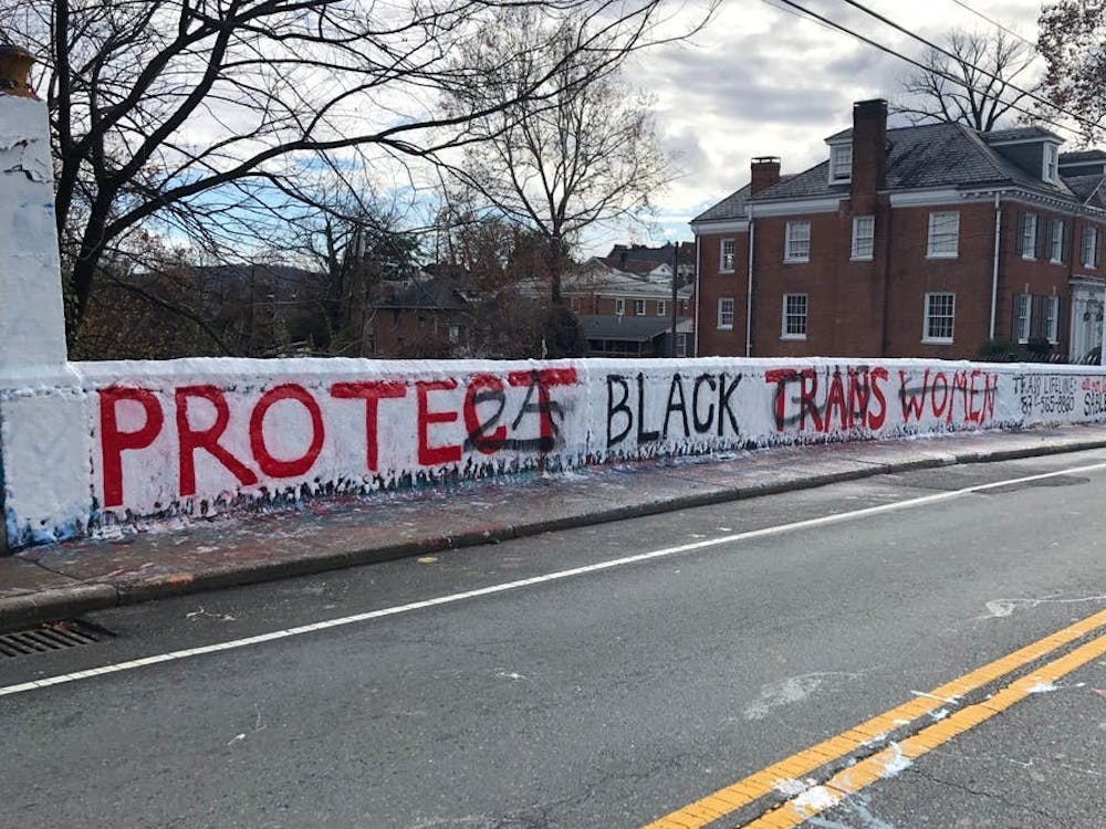 A few weeks after the original message was painted, it was defaced with scrawls of pro-gun rhetoric in an act of violent hate speech against the transgender community.