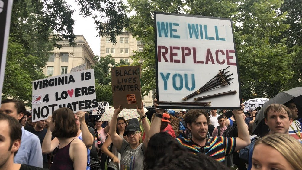 Several signs held by counterprotestors referenced last year's events in Charlottesville.