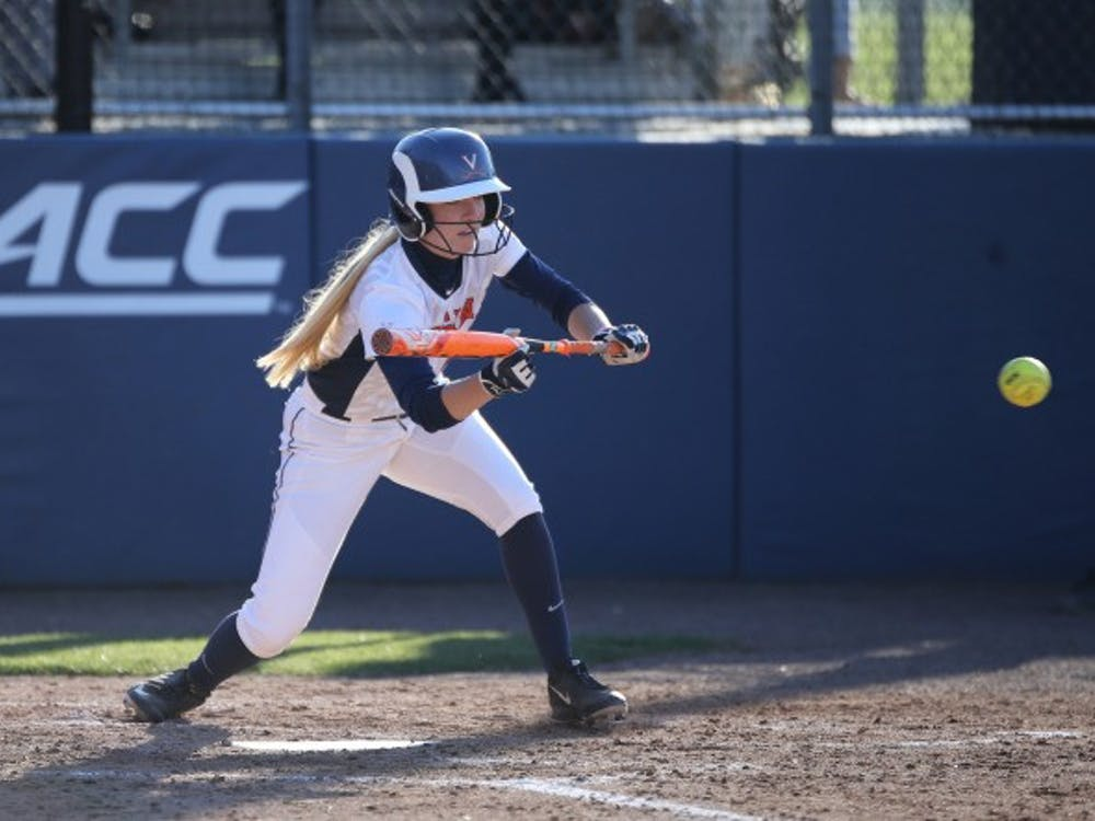 Senior McKall Miller scores Virginia's lone run in 10-1 loss to ECU.
