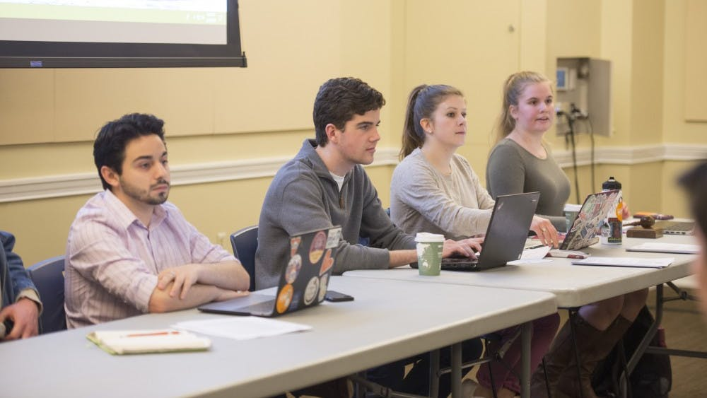 Student Council President-Elect Alex Cintron (left) at Tuesday's meeting.