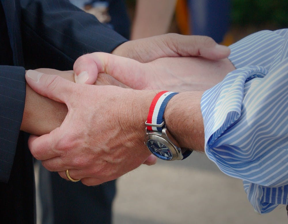 op-handshake-courtesywikipediacommons