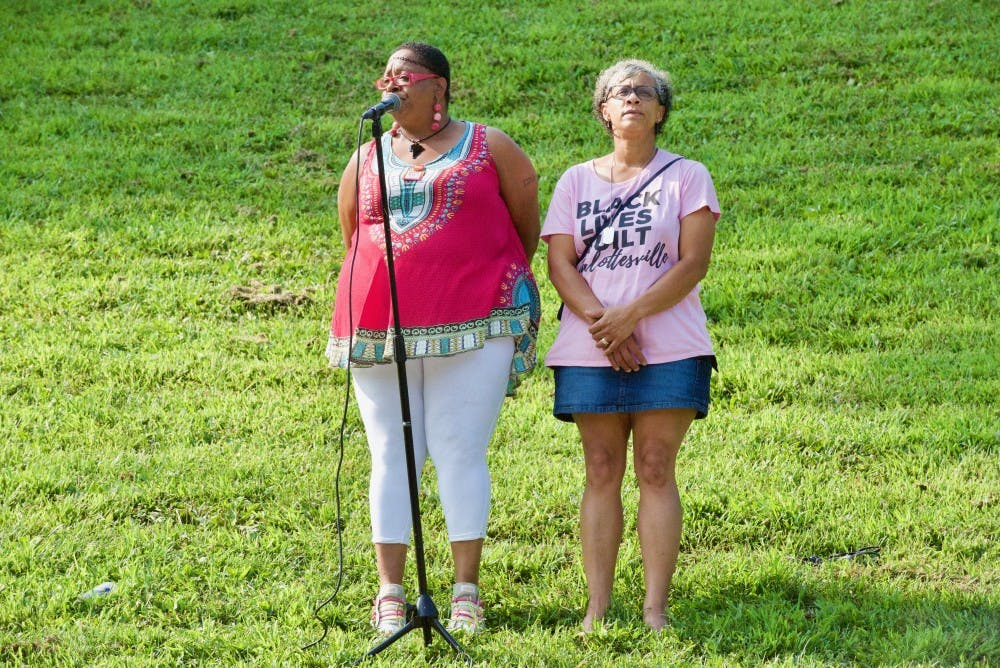 <p>Rosia Parker (left) and Katrina Turner (right), both Charlottesville residents and members of the City's Police Civilian Review Board, spoke at Sunday's rally.&nbsp;</p>
