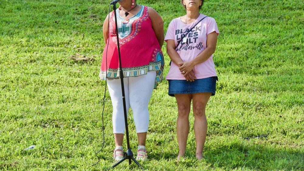 Rosia Parker (left) and Katrina Turner (right), both Charlottesville residents and members of the City's Police Civilian Review Board, spoke at Sunday's rally.