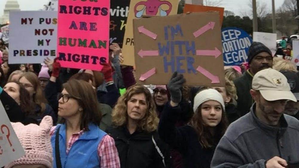Protesters at the Women's March in DC last week display signs.