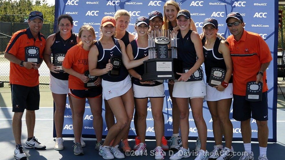 The Virginia women celebrate their  2014 ACC Women's Tennis Championship in Cary, N.C., April 27, 2014. Virginia won 4-2 over Duke. (Photo by Sara D. Davis, theACC.com)