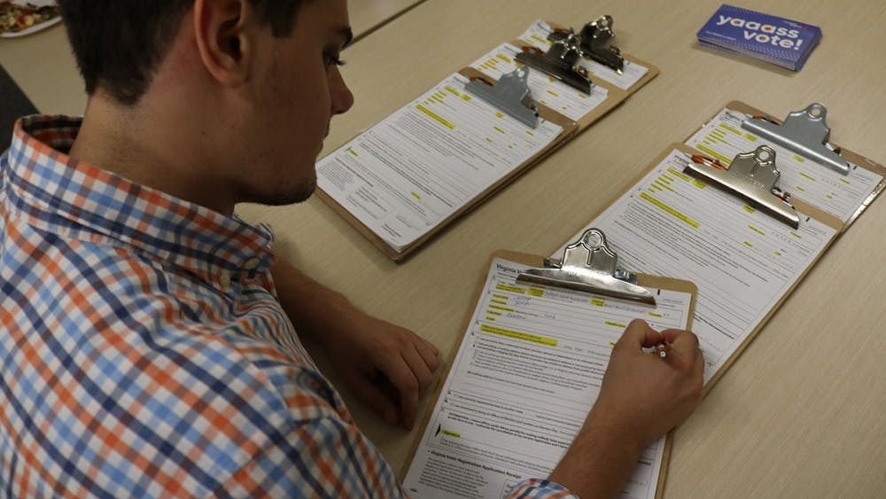 A student registers to vote at the Get Out the Vote event.