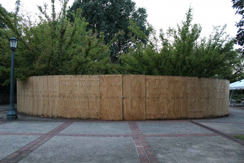 University spokesperson Wes Hester said the fence will be painted dark green soon — the fence is meant to surround the memorial only temporarily while the University reviews options for a replacement stone.