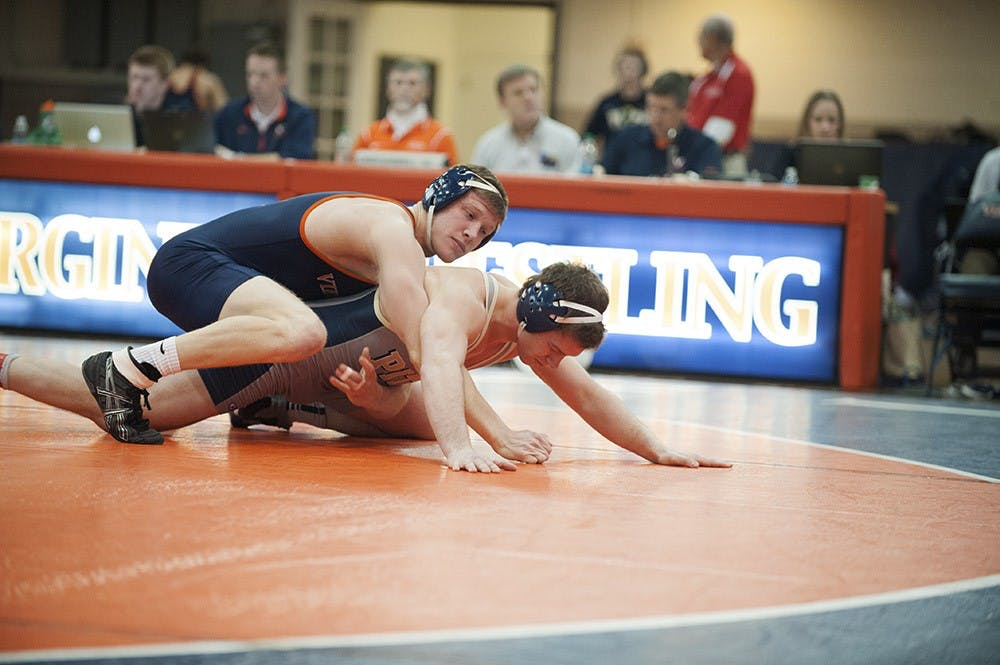 <p>Senior Nick Sulzer and the Virginia wrestling team face a stiff test in top-ranked Iowa. The Cavaliers and Hawkeyes get going at 2 p.m. Sunday. </p>