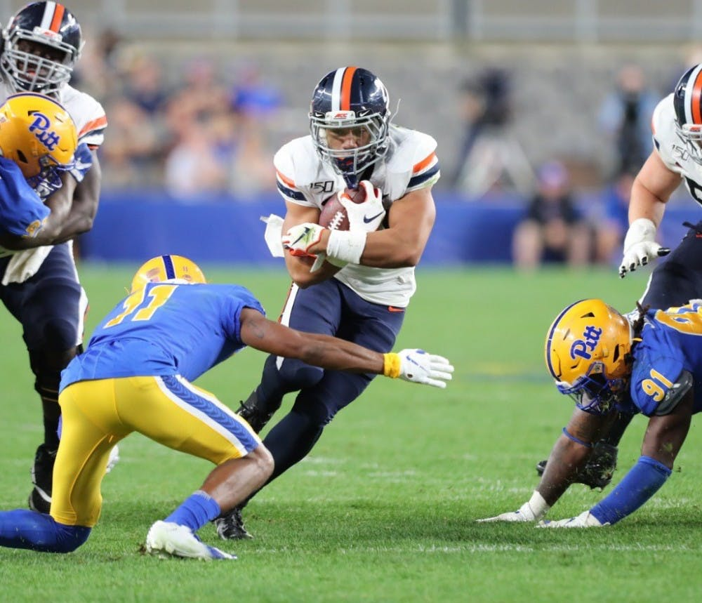 <p>Sophomore tailback Wayne Taulapapa has established himself early as Virginia's lead running back for 2019.</p>
