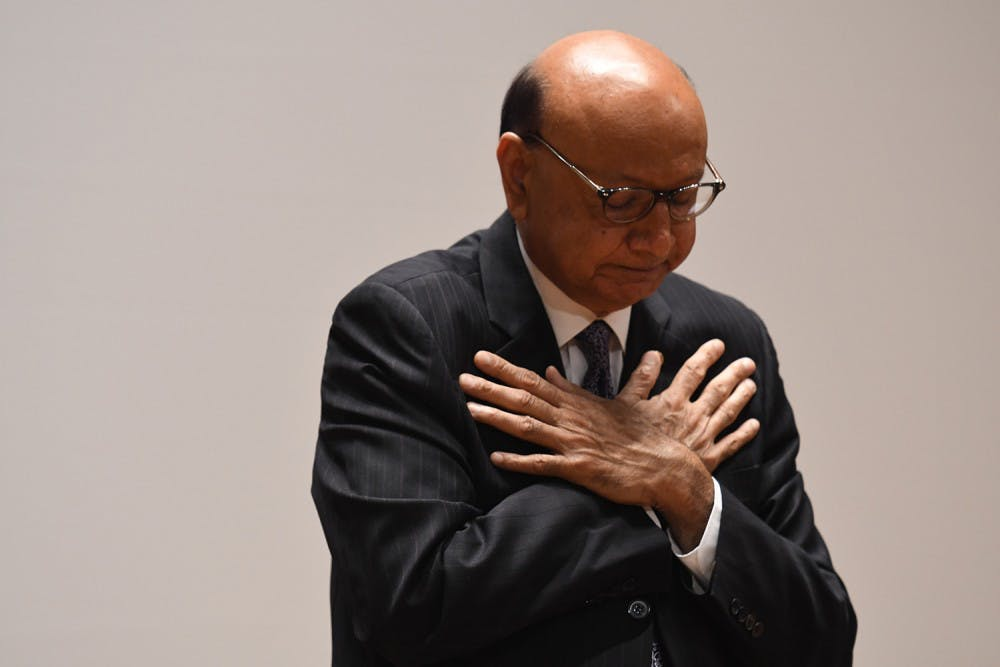 <p>Khan received a standing ovation before and after he spoke at Old Cabell Hall.</p>