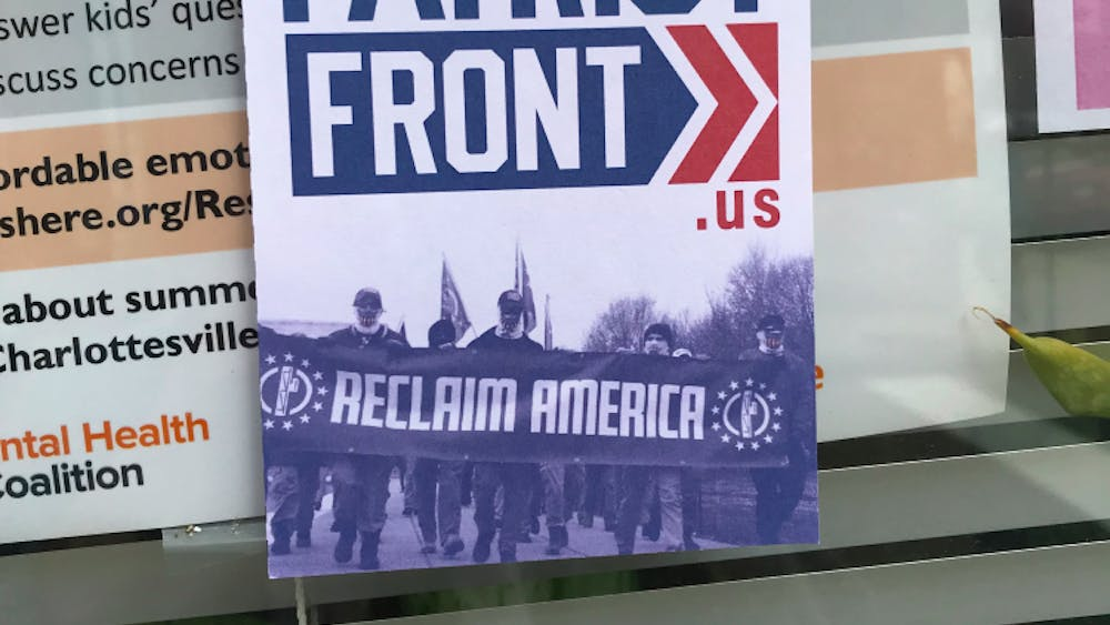 As of Monday evening, the flyers around Heather Heyer Way had been destroyed and replaced with anti-fascist stickers.