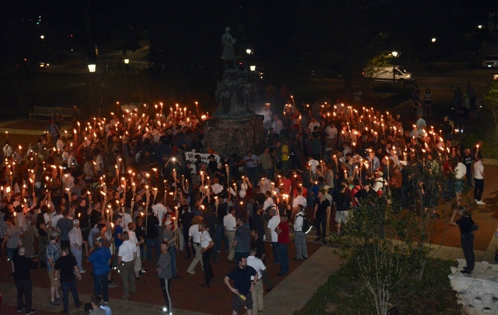 <p>The Aug. 11 torchlit march ended with white supremacists surrounding anti-racist demonstrators near the Jefferson statue north of the Rotunda.&nbsp;</p>