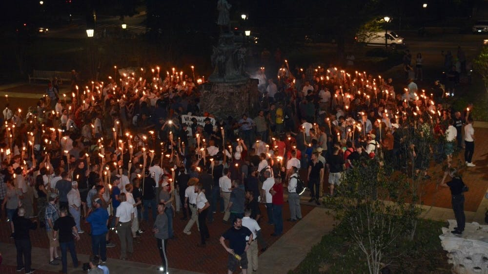 The Aug. 11 torchlit march ended with white supremacists surrounding anti-racist demonstrators near the Jefferson statue north of the Rotunda.