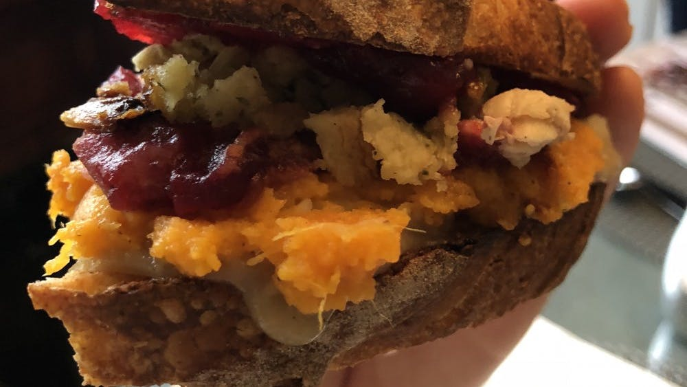 The ultimate Thanksgiving sandwich can be made from leftover stuffing, bread slices slathered with gravy and cranberry sauce, mashed potatoes, sweet potato casserole and turkey.