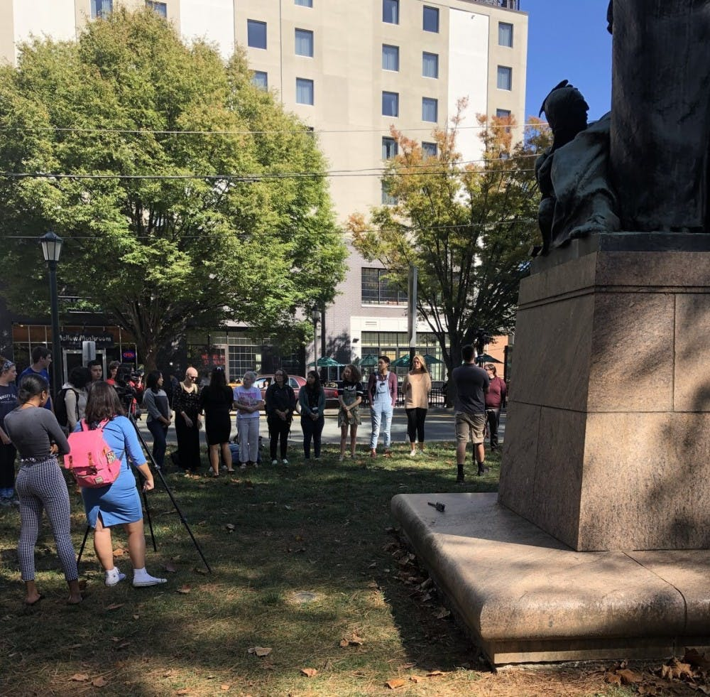 <p>Participants marched along the Corner to the George Rogers Clark statue on West Main Street.</p>