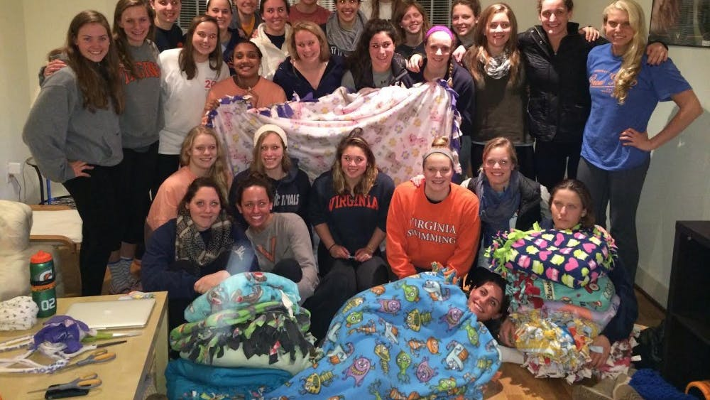 The Women's Swimming and Diving team made blankets for the U.Va. Children's Hospital as part of their effort to support Cure4Cam, an organization raisingawareness about humane treatments for childhood cancer patients.