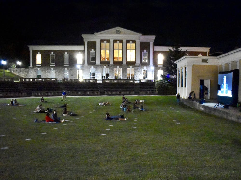 About 50 students sat in the grass and on the stairs of the amphitheater to watch, and the debate was projected onto a large screen in front of Bryan Hall.