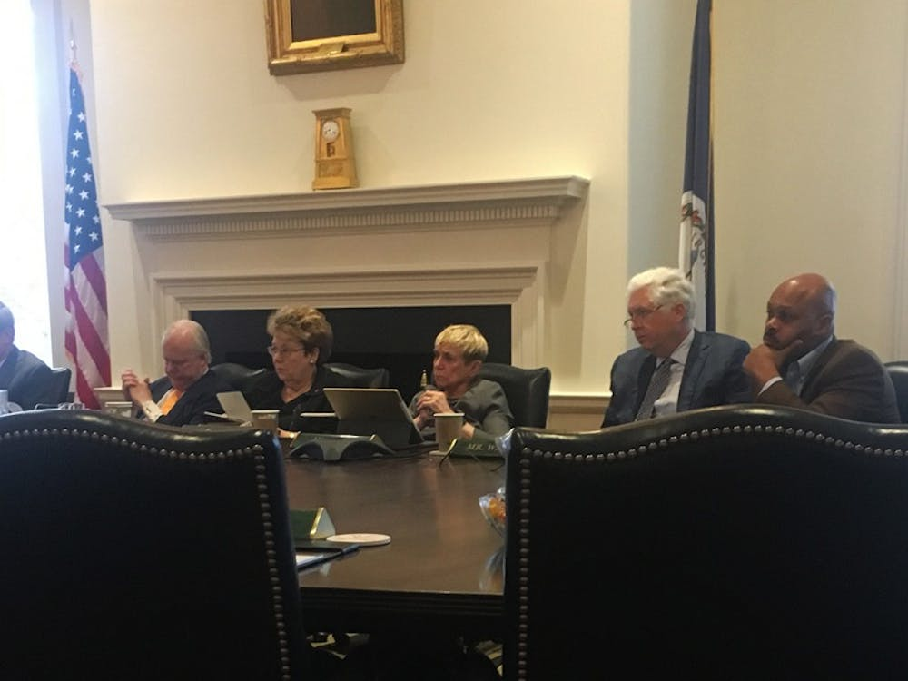 Members on the Ad Hoc Committee meet to address healthcare issues in the University.
