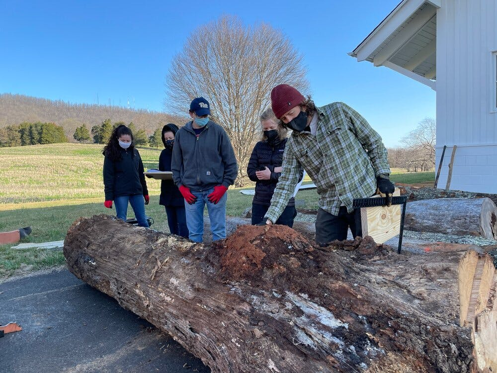 U.Va. Sawmilling invited volunteers to Morven Farms to participate in a milling day, where logs would be converted into more manageable pieces of lumber.