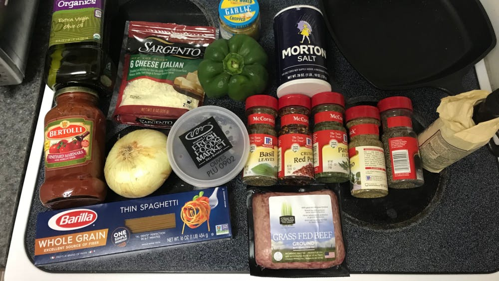 All of the ingredients necessary for pasta with meat sauce.