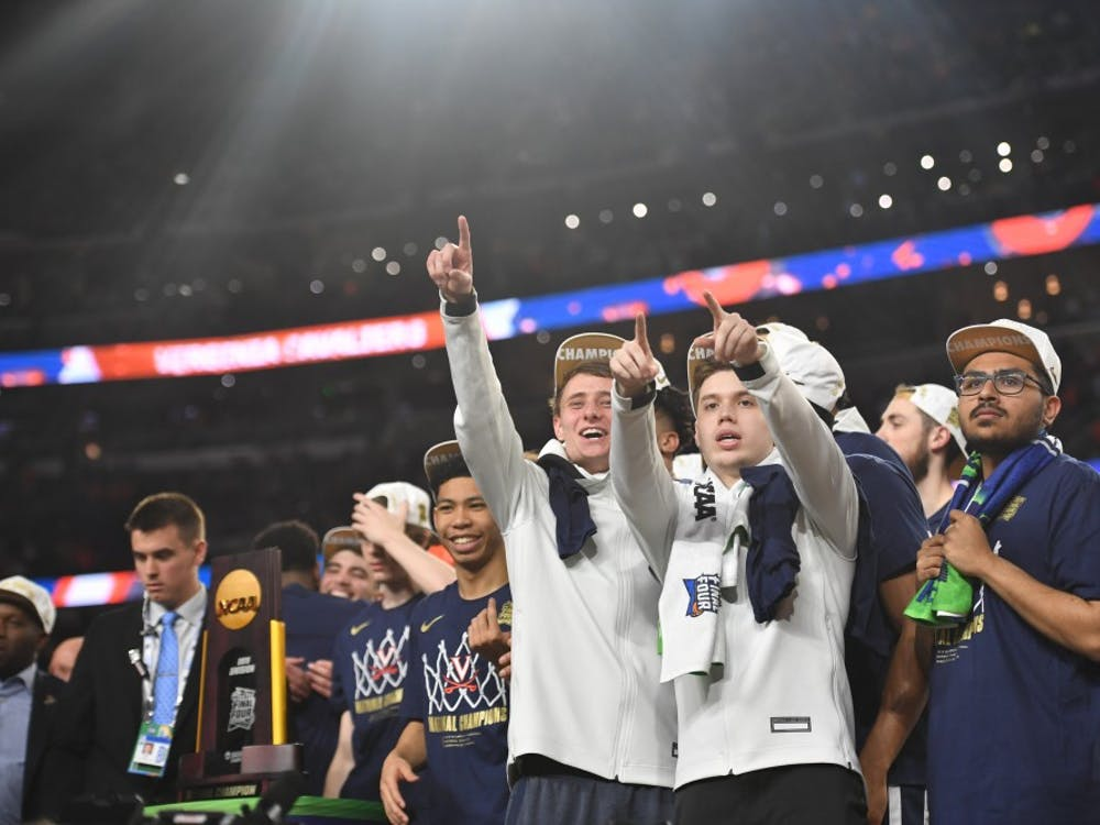 Senior student managers Grant Kersey, Justin Maxey and Faris Wasim celebrate Virginia's first National Championship in program history in Minneapolis.