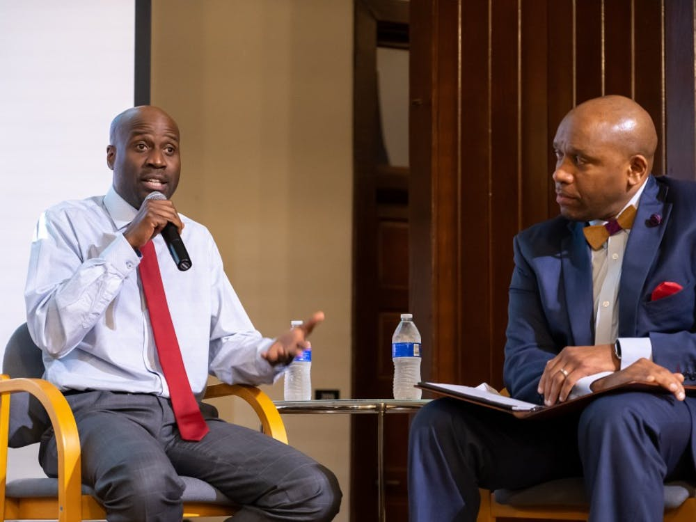 Artist Bayeté Ross Smith talks on Oct. 16 at the Jefferson School African American Heritage Center with Kevin MacDonald, the University's Vice President of Diversity, Equity and Inclusion.