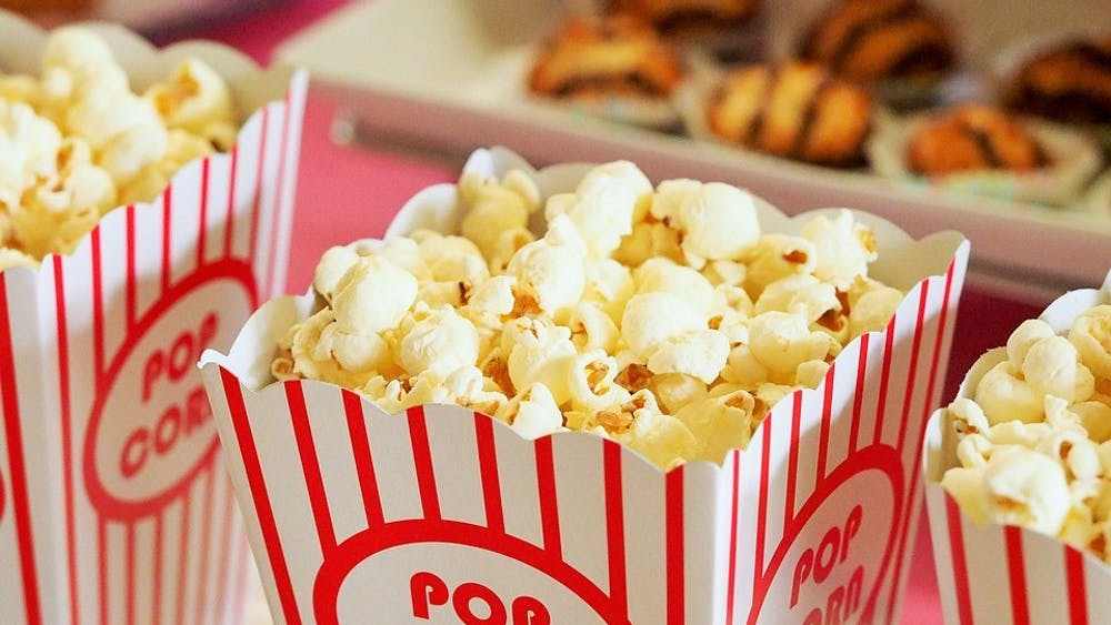 Theater popcorn can cost around $7, but buying a box of microwave popcorn at the store is much cheaper.
